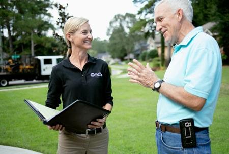 SkyFrog Landscape talking to a client.